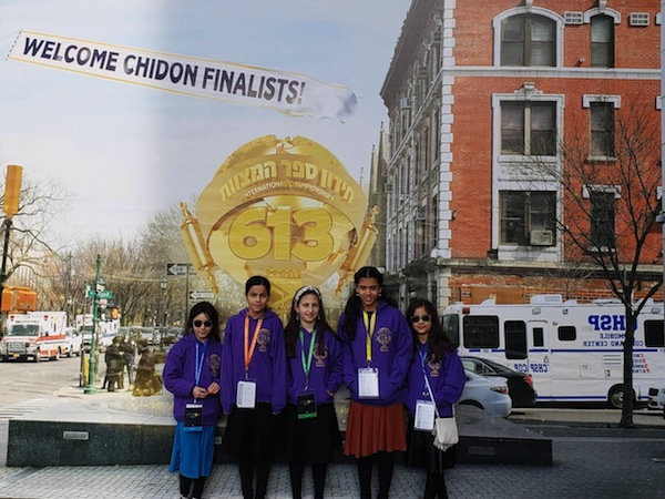 photo - Left to right: Chana Rivka Bitton, Miriam Feigelstock, Baila Shapiro, Shira Oirechman and Ora Yeshayahu. The biggest event of the Tzivos Hashem year is a Shabbaton in New York, the highlight of which is an international competition called Chidon Sefer Hamitzvos, where kids from around the world compete in their knowledge and understanding of the 613 mitzvot of the Torah, as codified by Maimonides