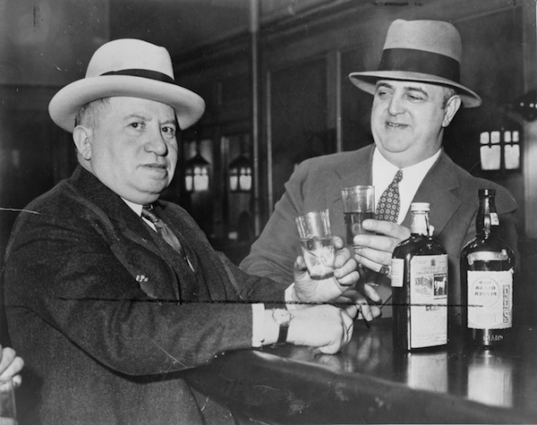 photo - Izzy Einstein and Moe Smith sharing a toast in a New York bar, 1935