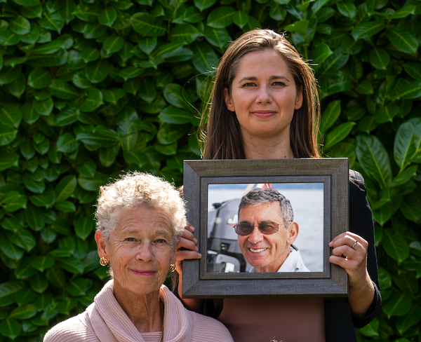 photo - Jane Remocker and her daughter, Catriona, holding a photo of Geoff Remocker, who passed away in 2016 from pancreatic cancer