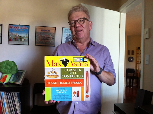 photo - Andy Muchin with a record from his collection
