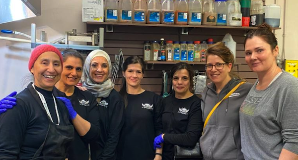 photo - The interfaith initiative at Boyle Street Community Services was led by Nesrine Merhi-Tarrabain, third from the left, and Rabbi Gila Caine, second from the right