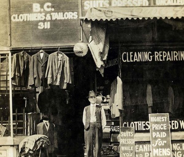 photo - An unknown man outside one of Mrs. Ann Snider's tailor shops, circa 1915