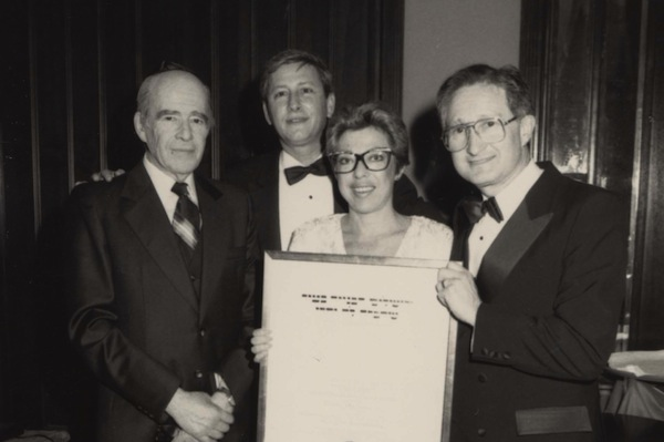 photo - Two unidentified people on the left with Gail and Michael James on the right holding a certificate at a Jewish National Fund event