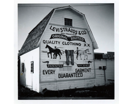 """photo - According to the company's website, the trademark depicting two horses attempting to pull apart a pair of Levi's waist overalls, symbolizes """"the strength of the clothing in the face of competition."""" It was introduced in 1886"""