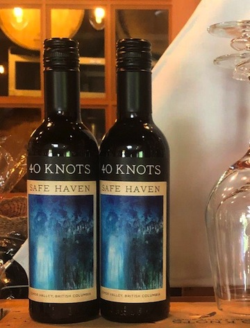 "photo - Monica Gewurz's painting ""Ebbing"" adorns the label of 40 Knots Vineyard and Estate Winery's Safe Haven fortified wine"