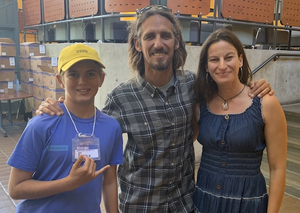 photo - Chatting surf, water refill stations and plastic pollution at Ocean Heroes Bootcamp, left to right: Enzo Ackermann (Ocean Hero), Rob Machado (professional surfer/environmentalist) and Sondra Weiss (art educator).
