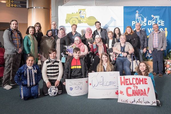 photo - The Alsidawi family, sponsors and congregants at the Vancouver International Airport, January 2019