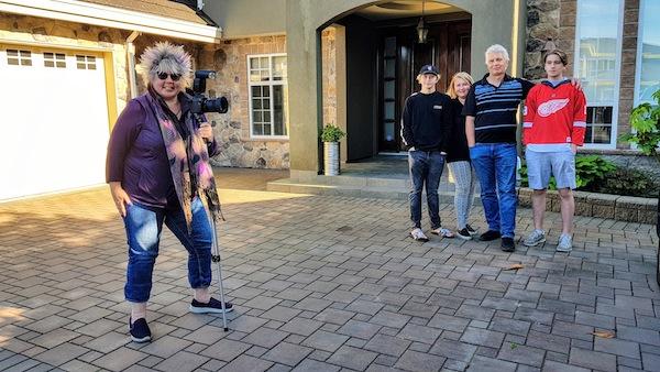 "photo - Lianne Cohen prepares to take a ""PORCHtrait"" of the Gorski family"