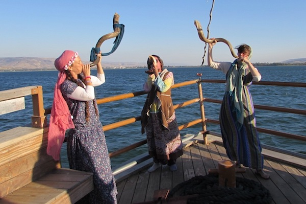 photo - Left to right: Devorah Abramson, Yehudit Dribben and Sheva Chaya blow the shofar at Miriam's Well on Lake Kinneret