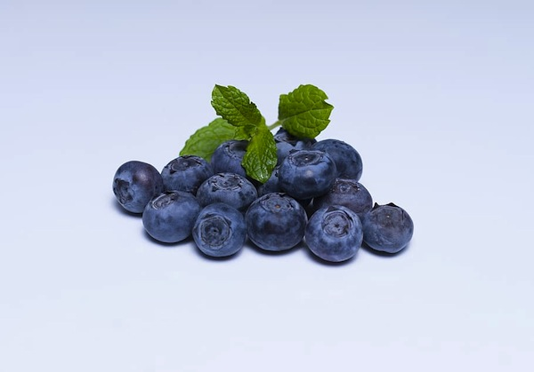 photo - Blueberry Bottom Pie is garnished with blueberries and fresh mint
