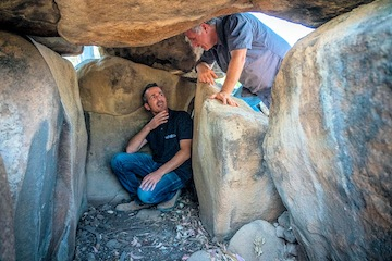 photo - Uri Berger of the Israel Antiquities Authority, left, and Prof. Gonen Sharon of Tel Hai Academic College inside a dolmen where a wall engraving was unexpectedly discovered