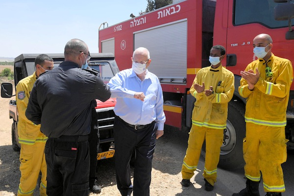 photo - Israeli President Reuven Rivlin with firefighters near the Gaza border earlier this week