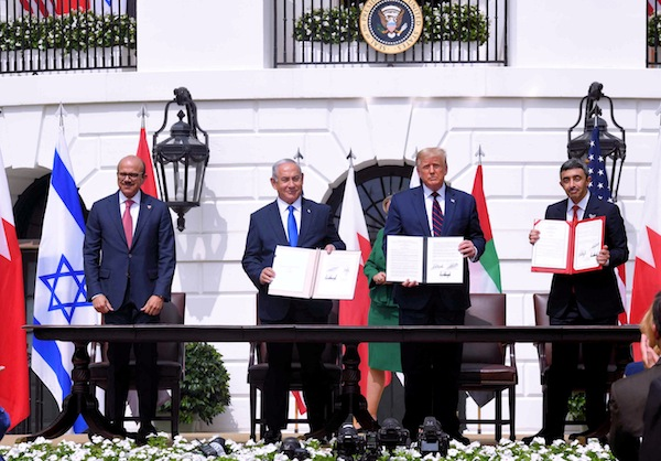 photo - Left to right: Bahrain Minister of Foreign Affairs Abdullatif al-Zayani, Israeli Prime Minister Binyamin Netanyahu, United States President Donald Trump and United Arab Emirates Minister of Foreign Affairs and International Cooperation Sheikh Abdullah bin Zayed sign the Abraham Accords on Sept. 15 at the White House in Washington, D.C.