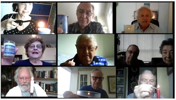 screenshot - As part of the Nov. 9 Kristallnacht commemoration, candles of remembrance were lit by Holocaust survivors in their homes