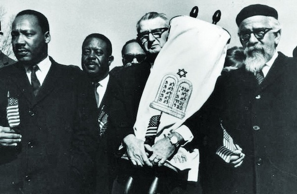 image - A still from the documentary Shared Legacies: From the left are Martin Luther King Jr., Ralph Abernathy, Maurice Eisendrath and Abraham Joshua Heschel during the march from Selma to Montgomery, 1965