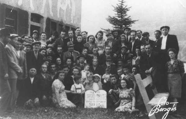 photo - A photo taken at a displaced persons camp in Germany, 1947. The author and her older brother, Hy, are in the centre, with their arms draped over each other