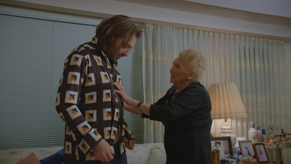 photo - A scene from the documentary Martha, in which director Daniel Schubert is given a more appropriate shirt by his grandmother, Martha Katz