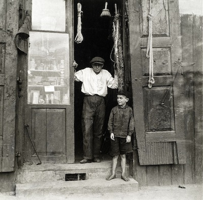photo - Tim Gidal's cousin Gershon in the doorway of the family's rope shop, in Lowicz, Poland. The photo was taken by Gidal in 1932