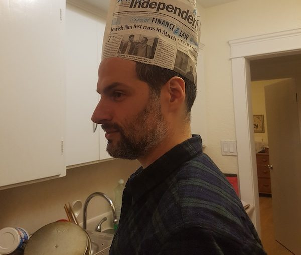 photo - Aaron Dewitt put the Feb. 12 issue of the Jewish Independent to good use on Purim – after reading it from cover to cover, we trust