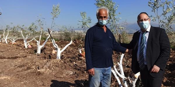 photo - Kiryat Shmona Mayor Avihay Shtern, left, with Rabbi Shlomo Raanan
