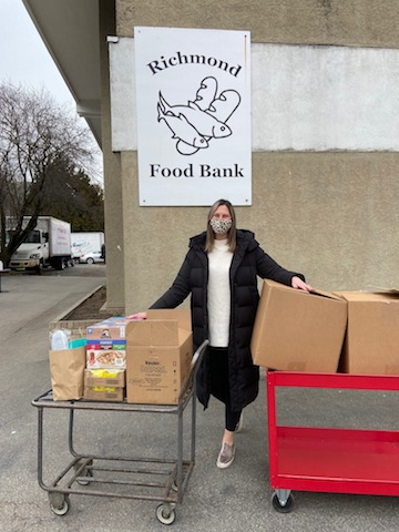 photo - Courtney Cohen outside the Richmond Food Bank, delivering donations