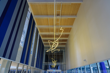 photo - The sculpture appears abstract to viewers moving through the space. Yet, from a specific vantage point, a representation of a bird appears
