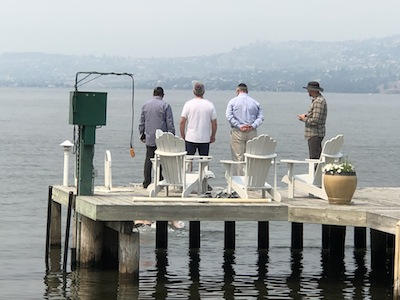 photo - The rabbis supervise the mikvah ceremony on Lake Okanagan