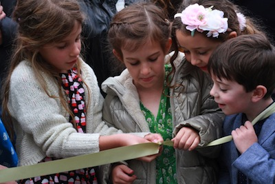 photo - The younger generation of the Dayson/Barnett family cut the ribbon at the opening of Tikva Housing Society's Ben and Esther Dayson Residences